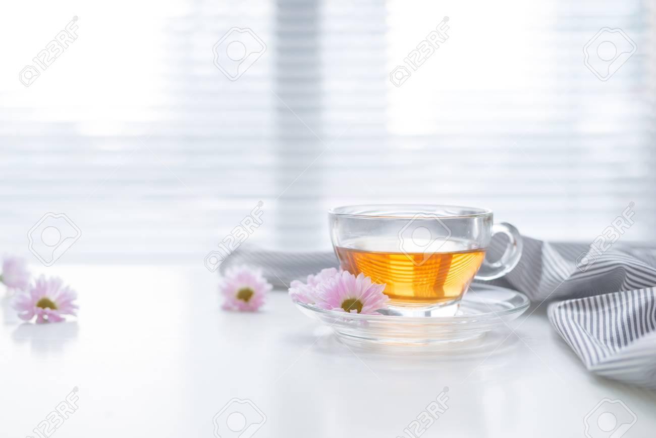 Cup of tea on the windowsill. Tea time. - 92646246