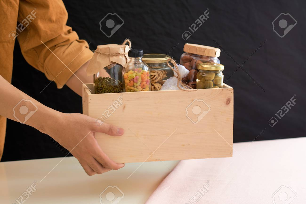 Volunteer with box of food for poor. Donation concept. - 96521094