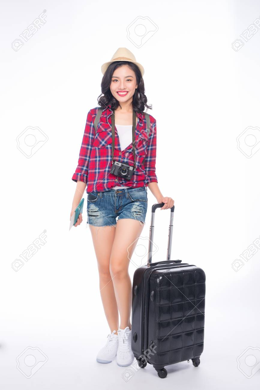 Woman travel. Young beautiful asian woman traveler with suitcase and camera on white background - 103390310