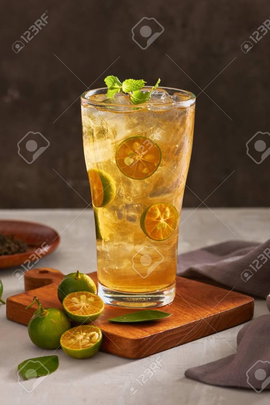 Glass of fresh drink cumquat lemonade tea. - 107207437