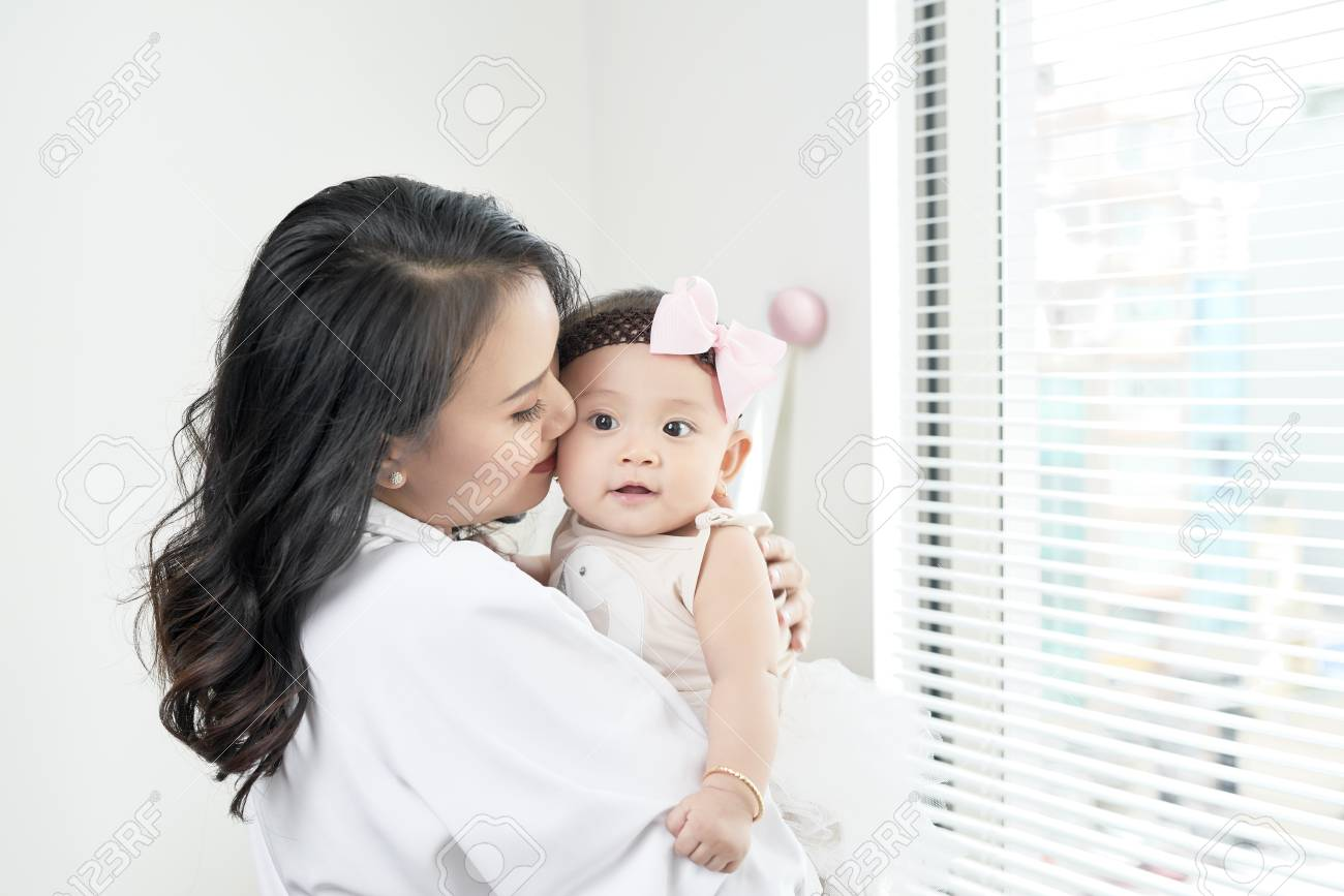 happy loving family. mother playing with her baby in the bedroom. - 108467148