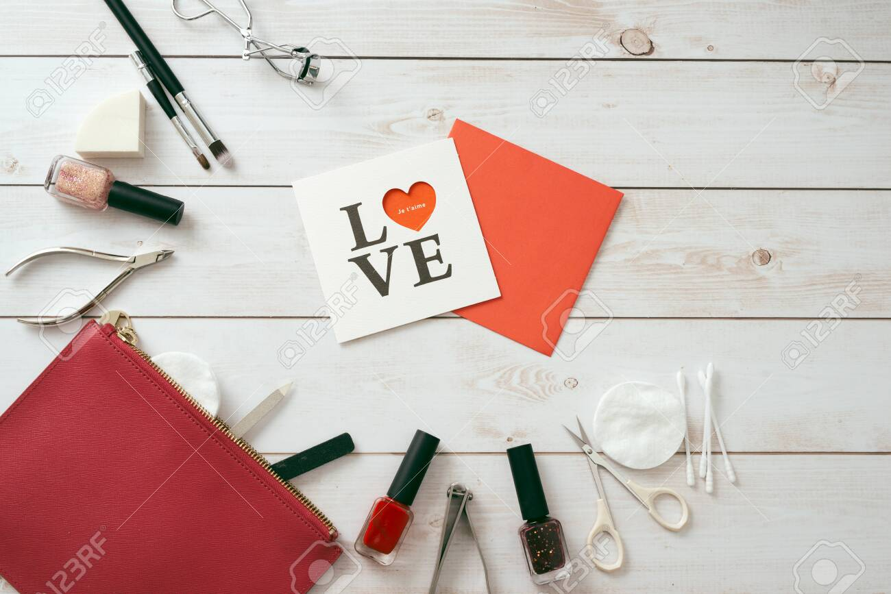 white card with a pattern in the form of heart, Manicure set and nail polish on wooden background. Valentine's Day. flatlay - 118439926