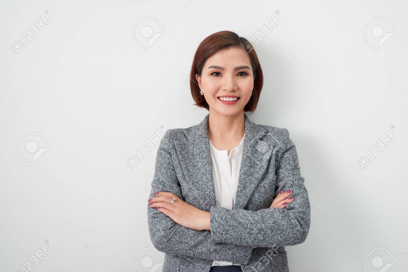 Entrepreneur young asian woman, business woman arms crossed on white background. - 120517160