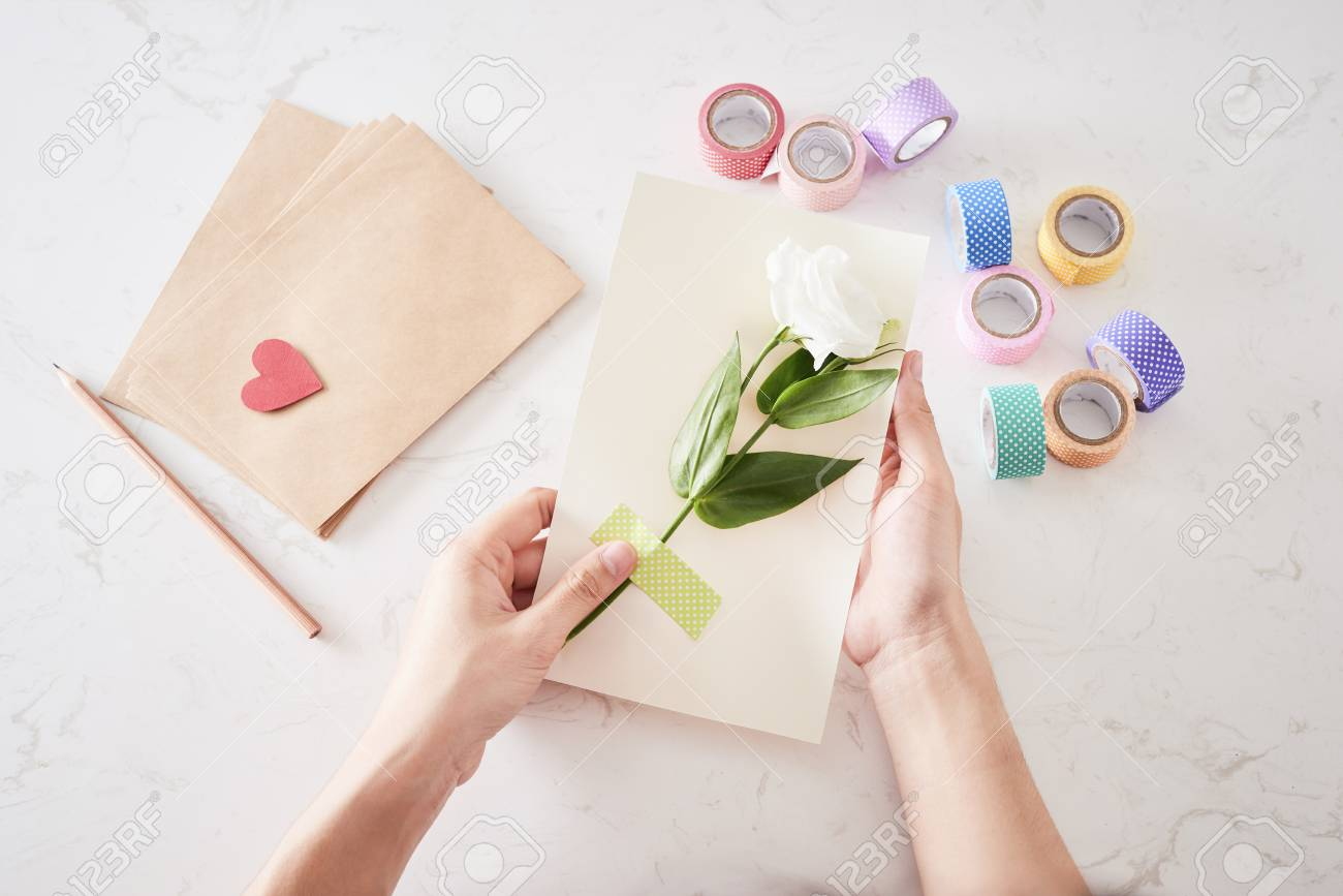 Making decorations or greeting card. Paper strips, flower, scissors. Handmade crafts on holiday: Birthday, Mother's or Father's Day, March 8, Wedding. - 120518494