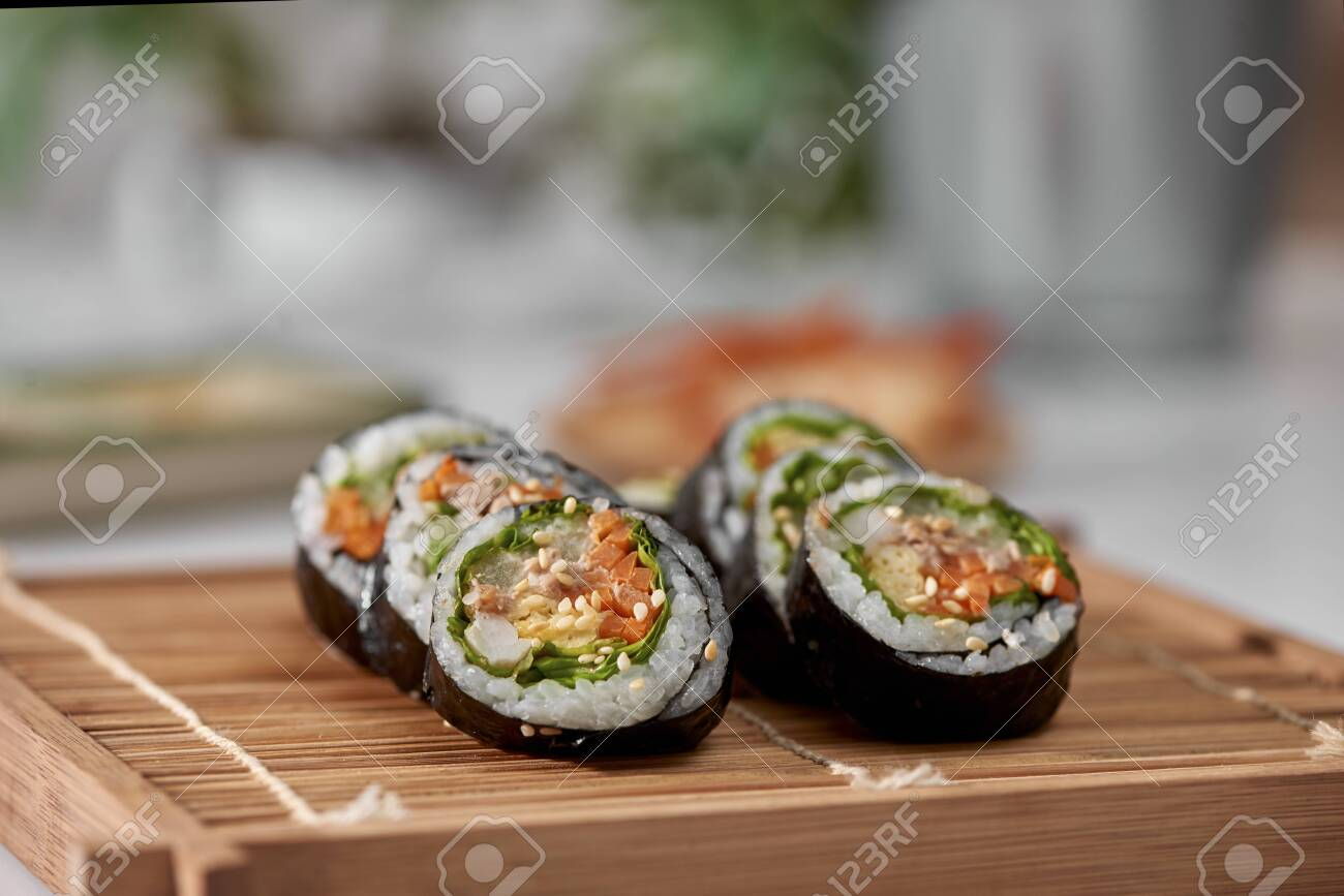 Korean roll Gimbap(kimbob) made from steamed white rice (bap) and various other ingredients - 123937682