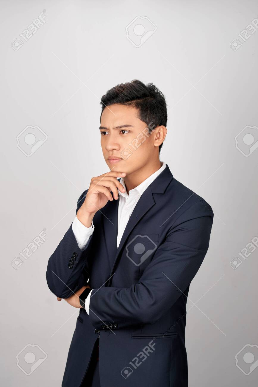 Portrait of attractive young asian businessman is confusing over white background - 127712283