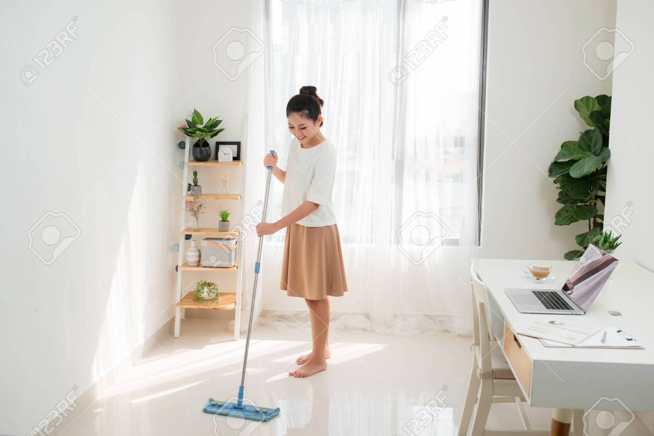 Young Asian woman doing cleaning at the home office. - 129672875