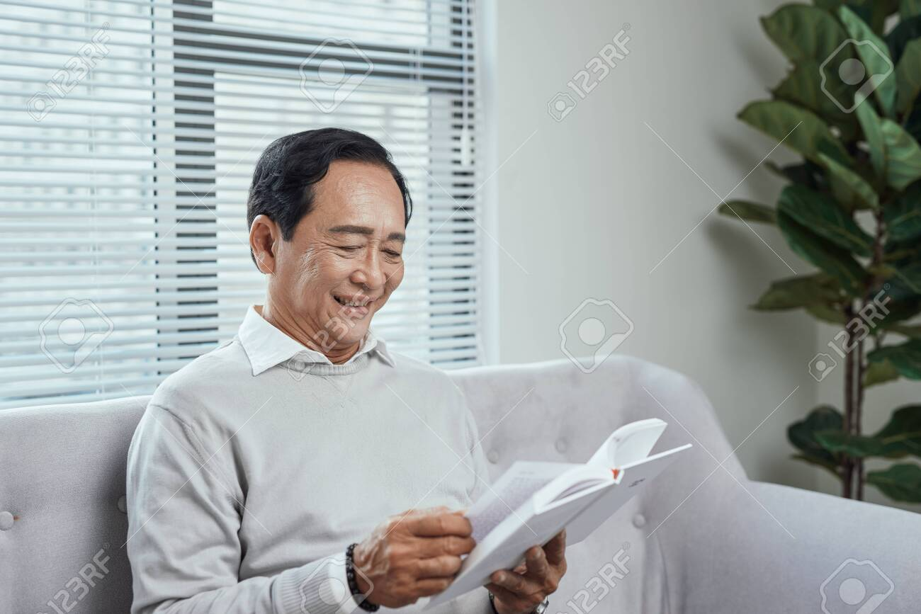 Senior Man Reading a Book - 133121043