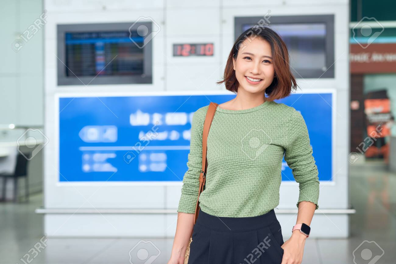Travel. Young woman goes at airport at window with suitcase waiting for plane - 133119968