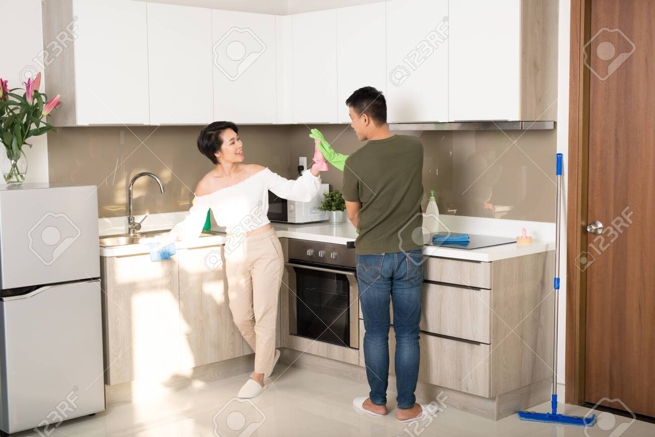 Young family couple doing cleaning in the house. Cleaning concept. - 145178435