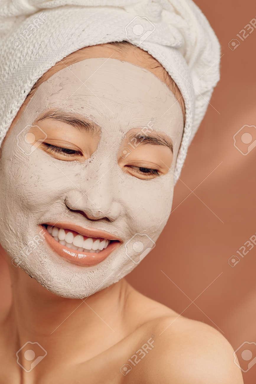 Young Asian woman enjoying of a facial mask treatment. - 152321554