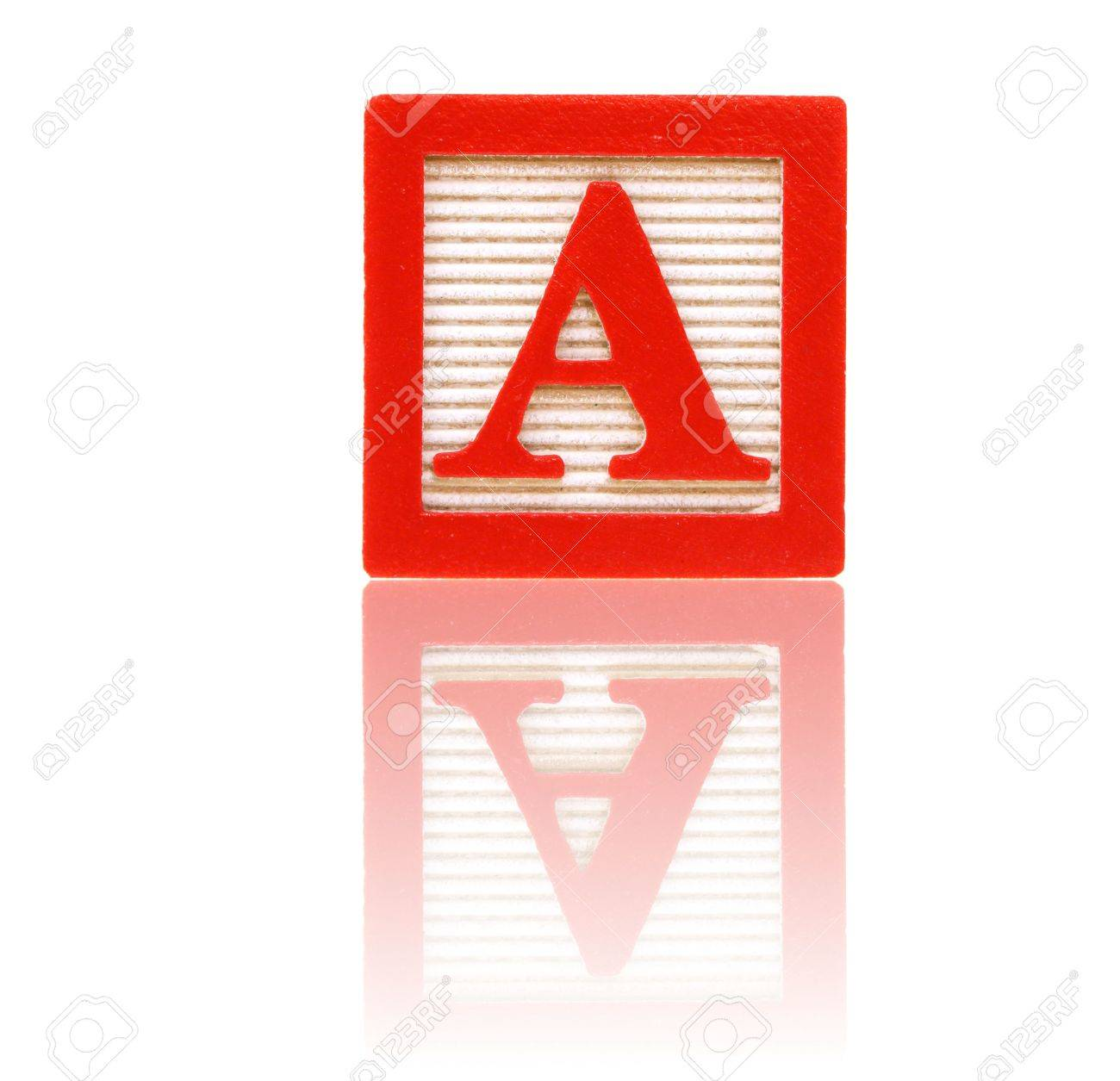 letter a in an alphabet wood block on a reflective surface Stock Photo - 3094471