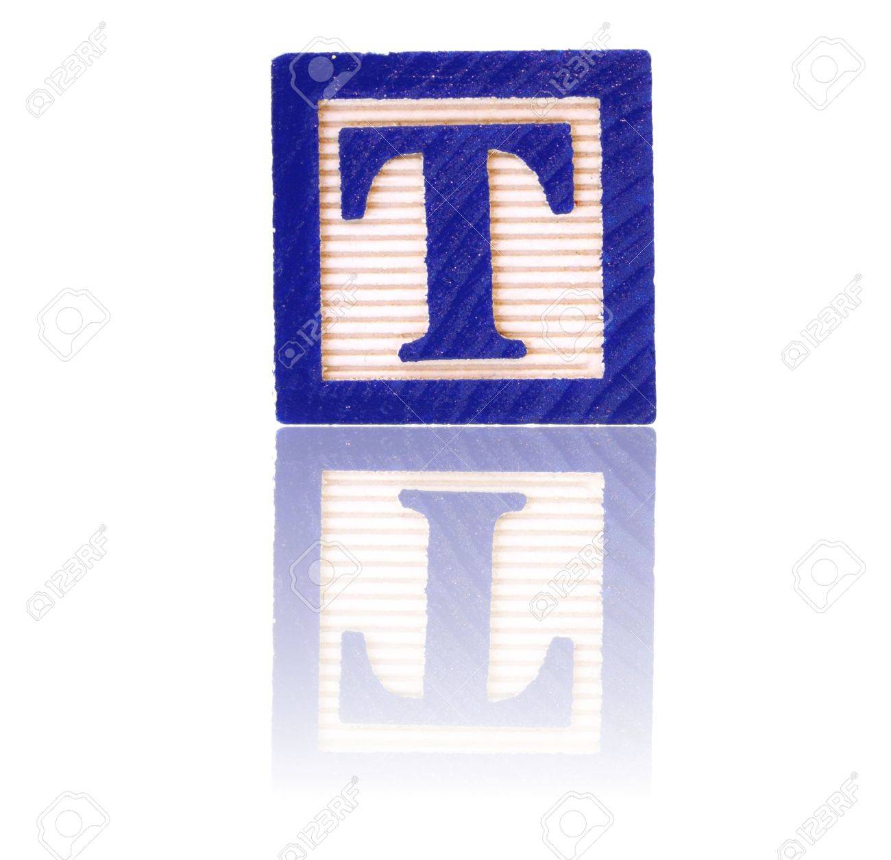 letter t in an alphabet wood block on a reflective surface Stock Photo - 3099368