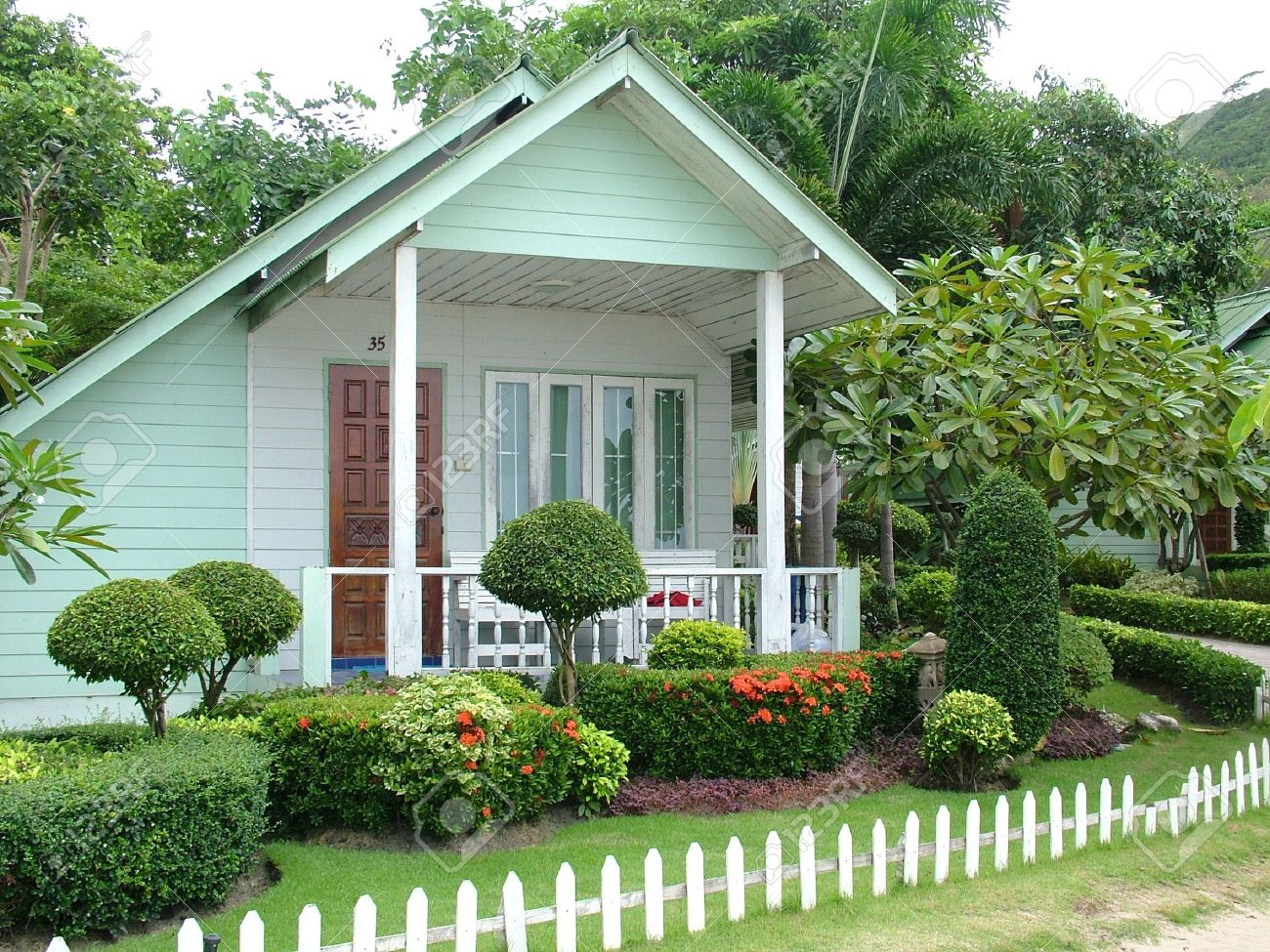 a small holiday cottage with garden stock photo picture and