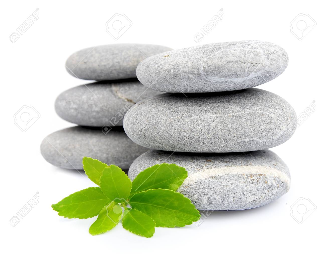 Zen Stones With Leafs On White Close Up Stock Photo Picture And Royalty Free Image Image 16530346