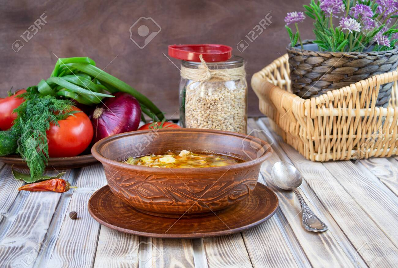 Traditional Georgian Kharcho soup with meat and rice on old wooden background. - 147153652