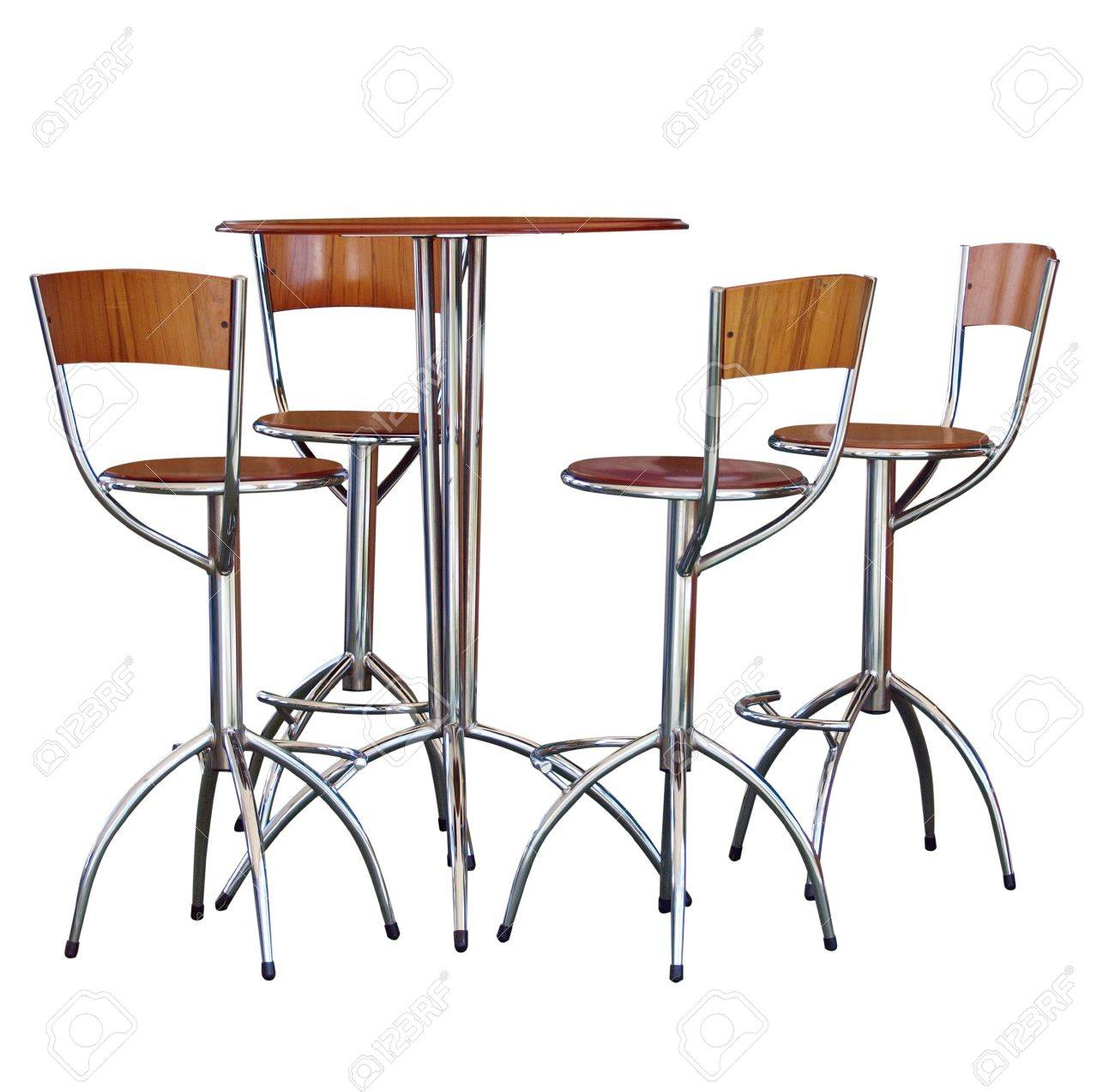 four tall bar stools at a table stock photo