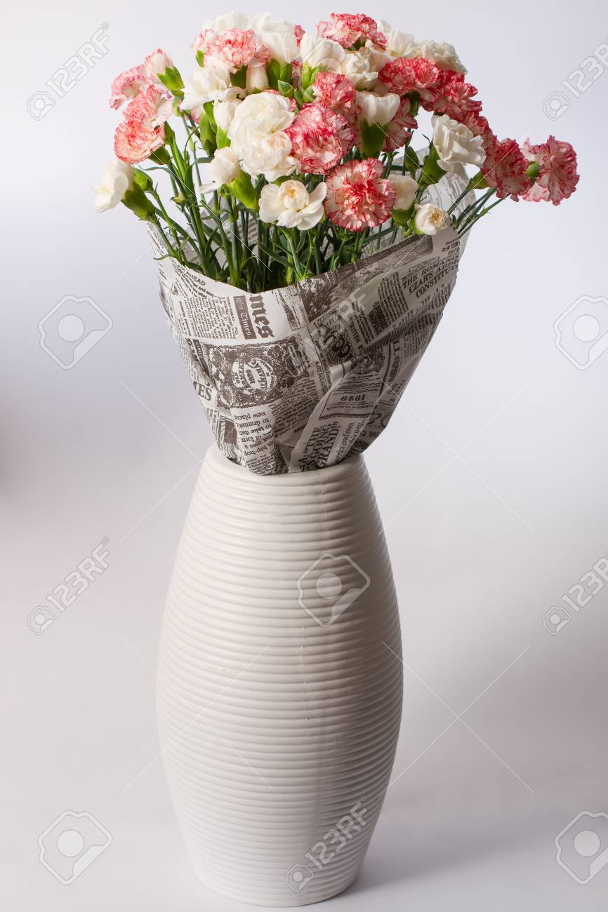Light Pink Bouquet Of Carnations In A White Vase Stock Photo Picture And Royalty Free Image Image 67485614