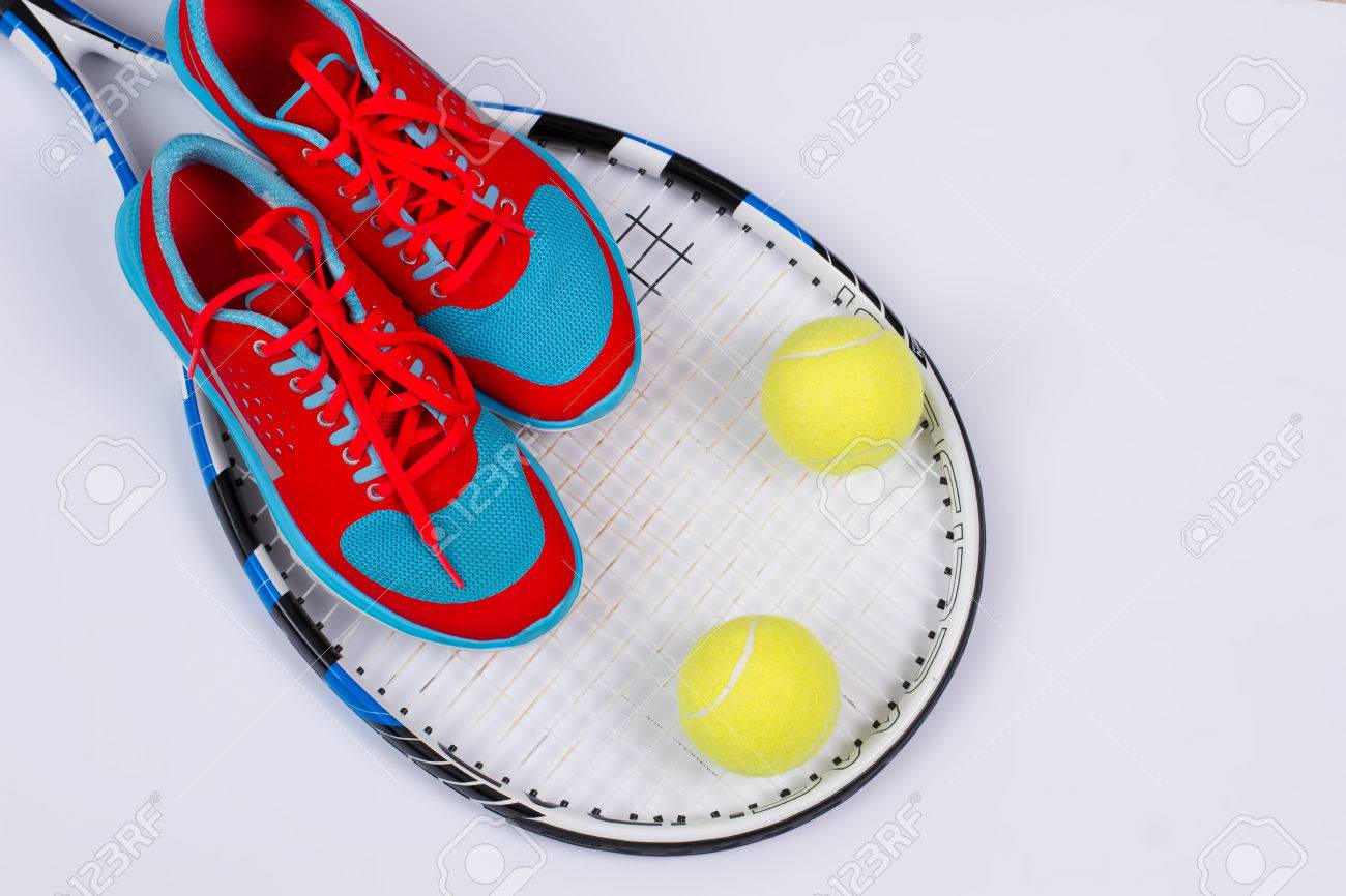 Bright Women's Running Shoes With Tennis Balls And A Tennis Racket.. Stock  Photo, Picture And Royalty Free Image. Image 67485791.