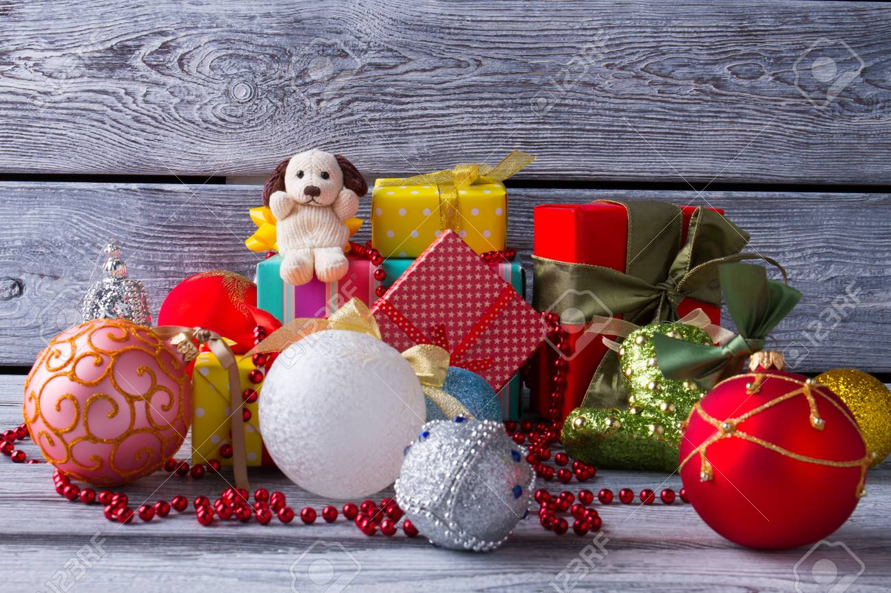 Pile Of Christmas Gifts And Toys On The Old Wooden Background ...