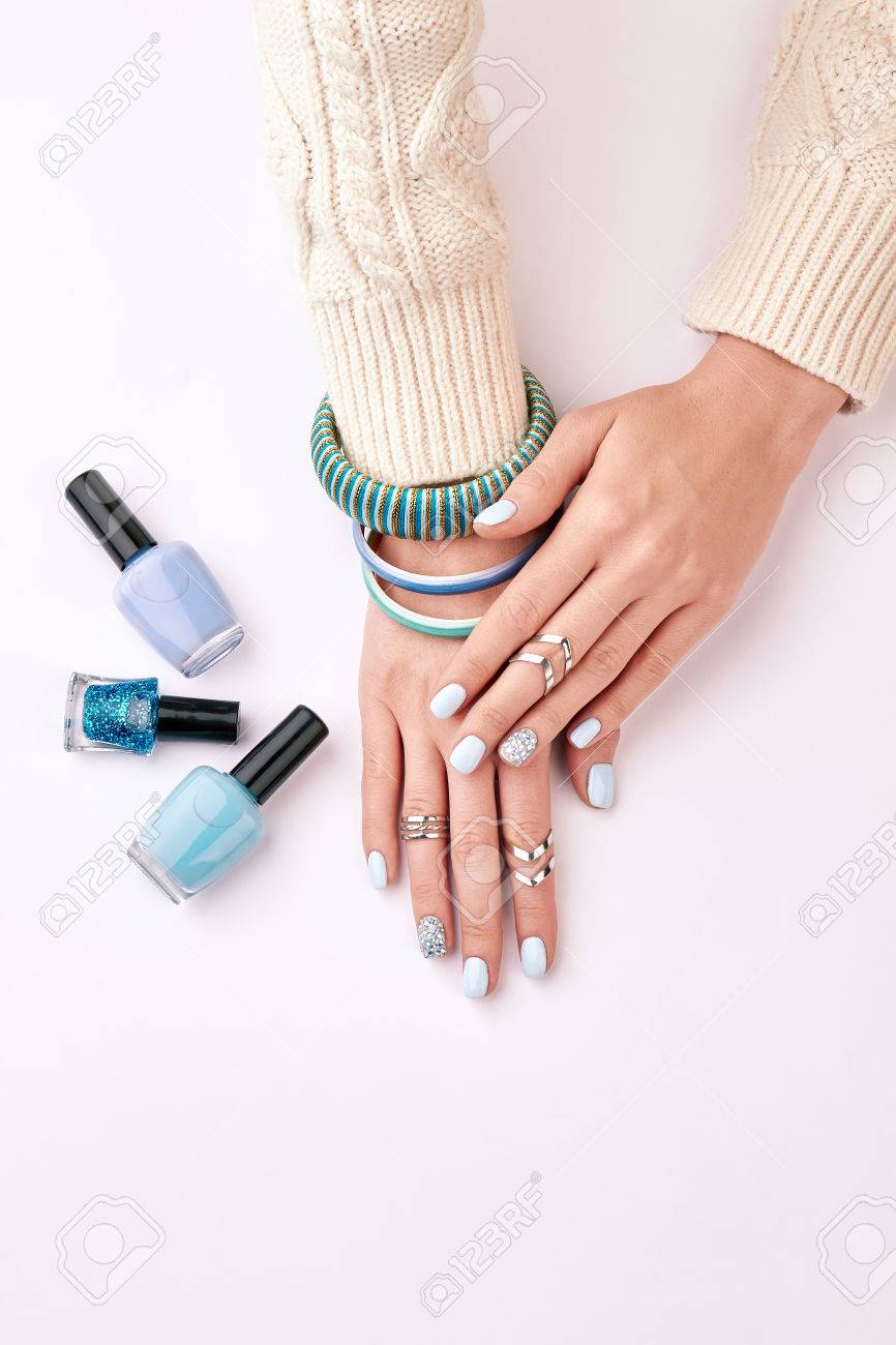 Silver Rings And Blue Bracelets On Women\'s Hands. Beautiful Nail ...