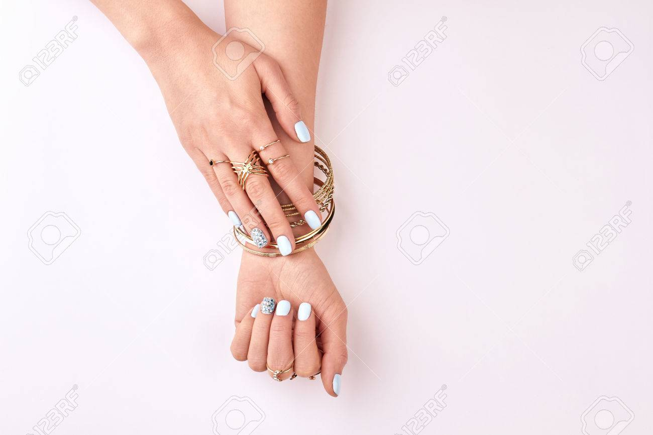 Female Hands In Rings And Bracelets On A White Background ...
