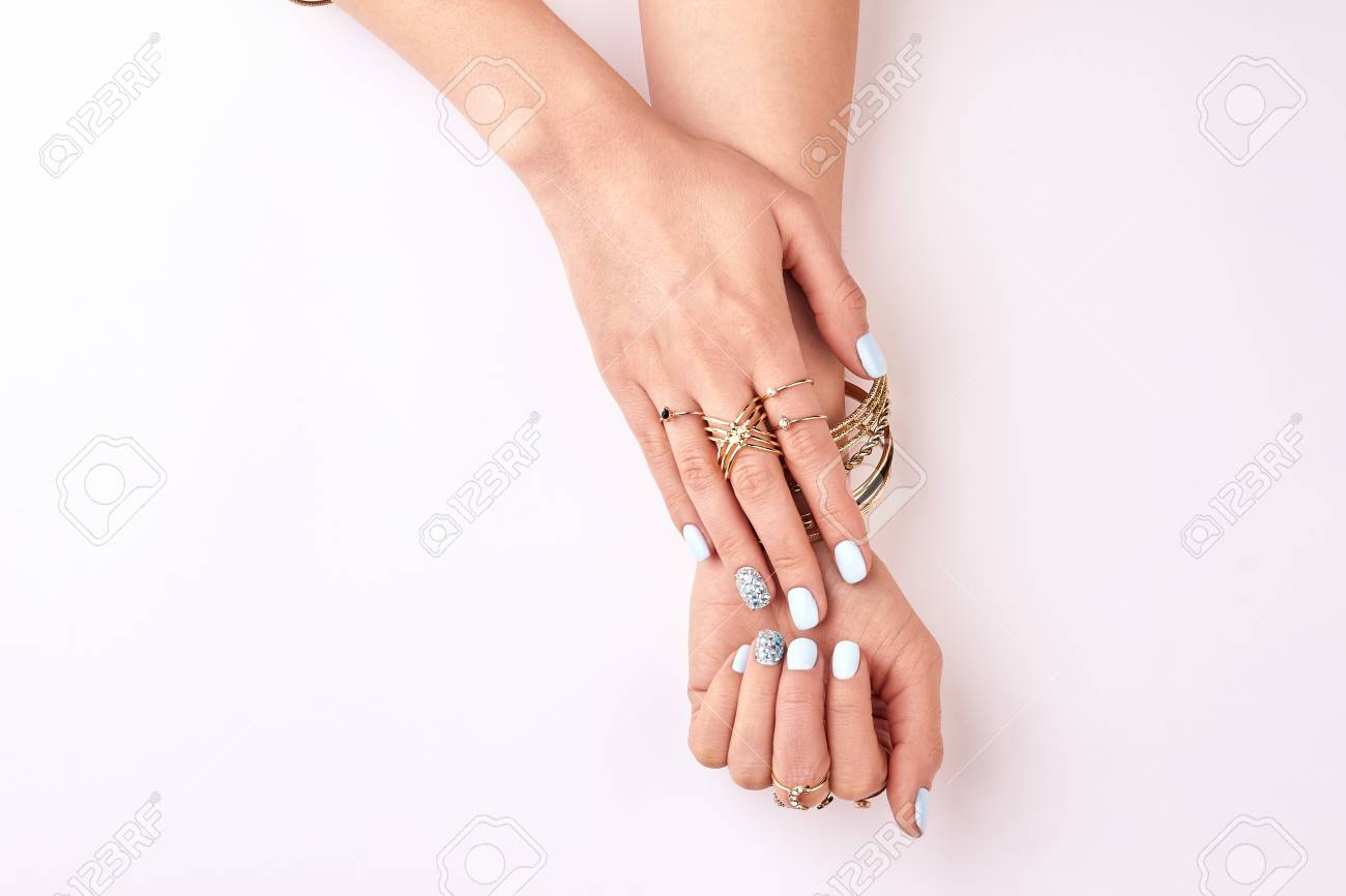 Beautiful Female Hands In Gold Bracelets And Rings. Fashionable ...