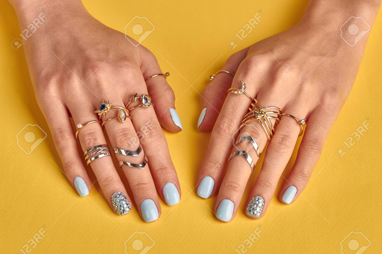 Female Hands With Manicure Closeup. Many Beautiful Gold Rings ...