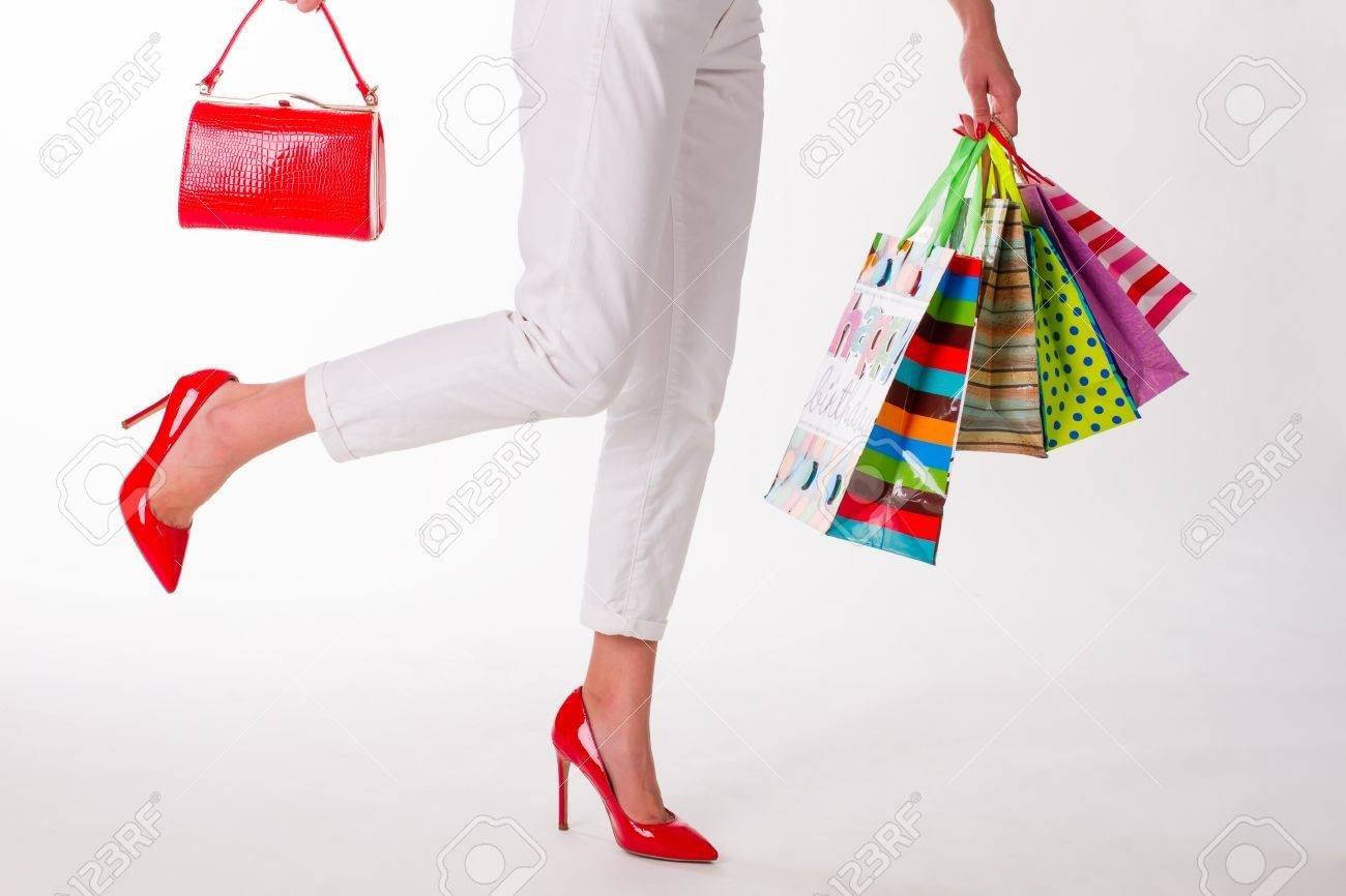 864f6af8c Lady in red shoes with red bag. Girl with colorful shopping bags. Fashion  girl