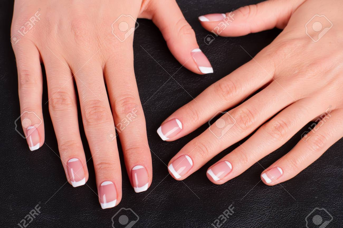 Stock Photo - Women s hands with a stylish manicure. Female hands on a  black leather background. e93b3d074