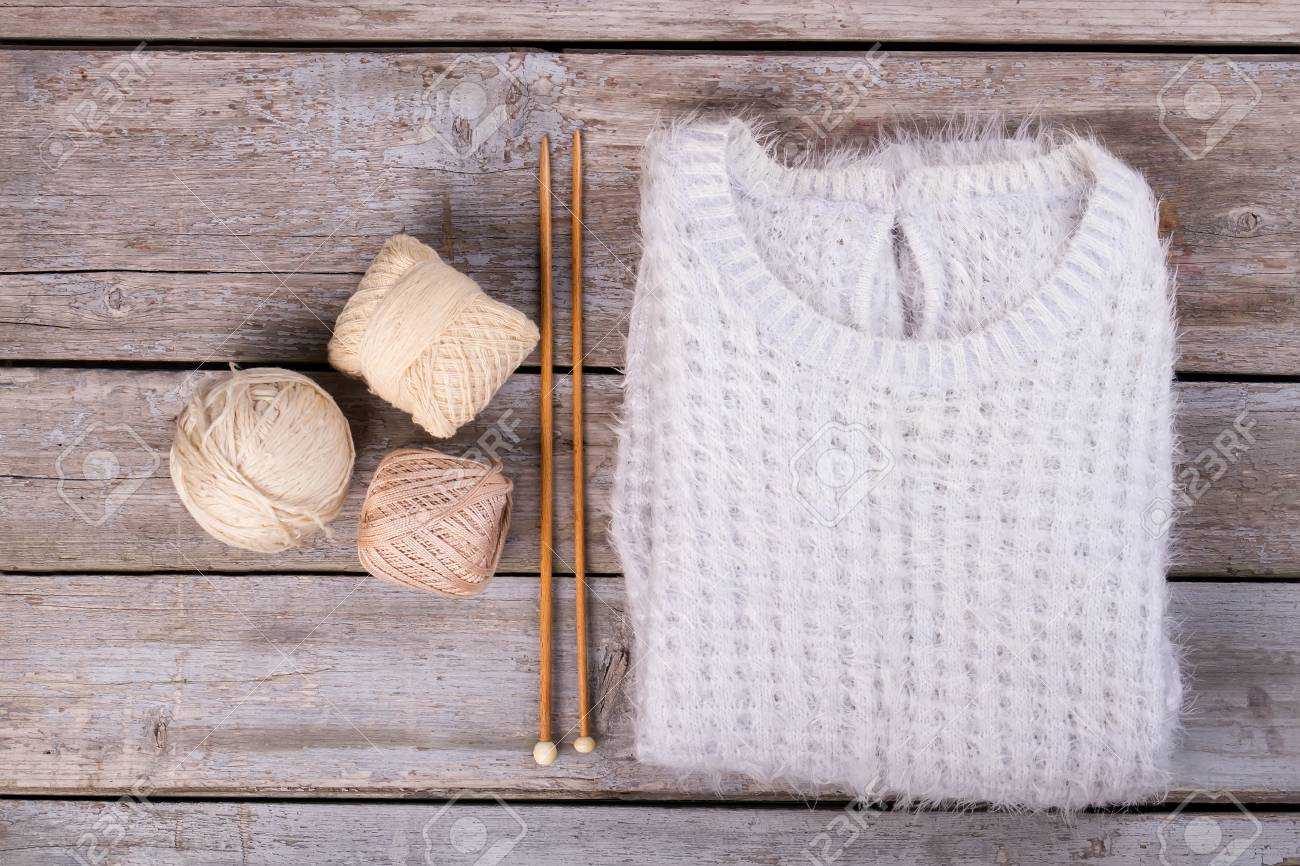 Trendy Downy Sweater With A Ball Of Yarn And Wooden Knitting Stock