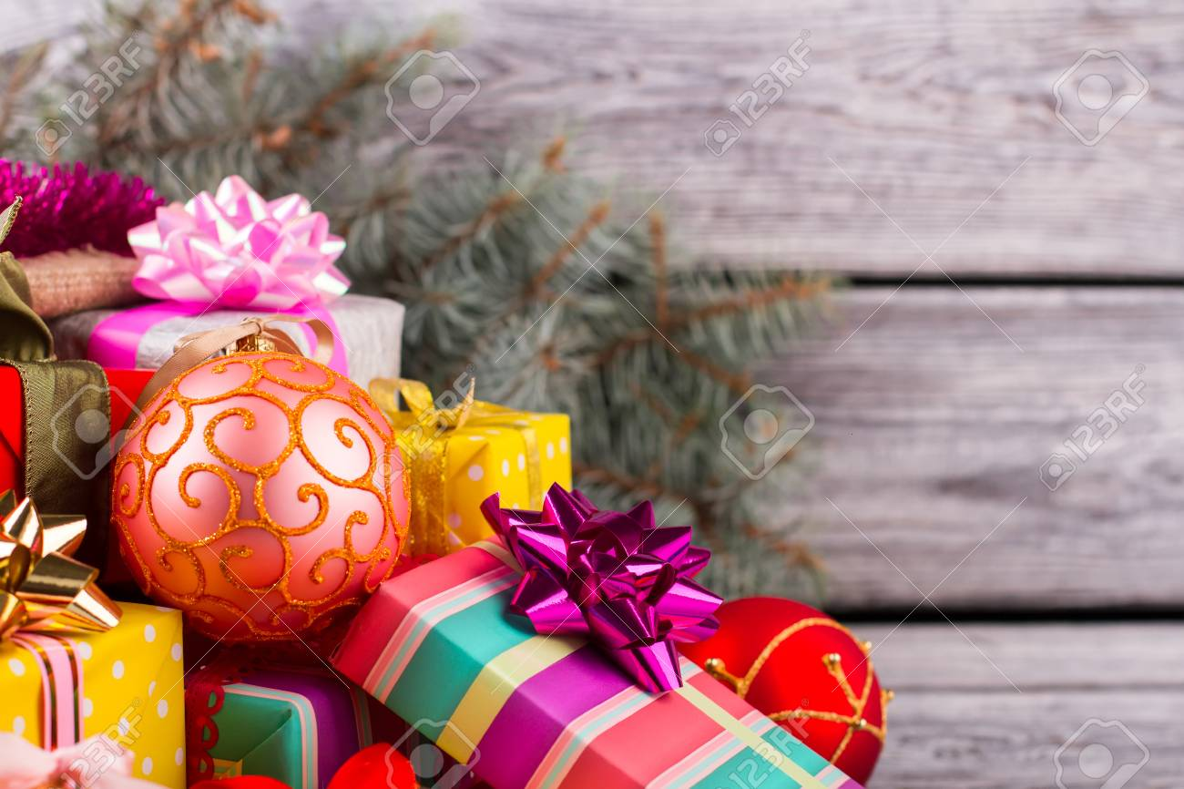 Beautiful Pink Ball With Christmas Gifts. Pile Of Colorful Gifts ...