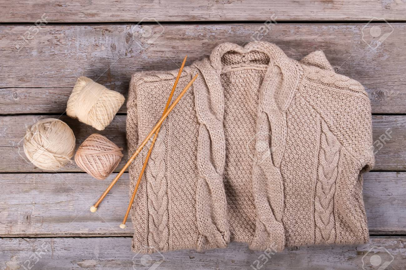 Knitted Sweater With Knitting Needles And Wool Trendy Winter