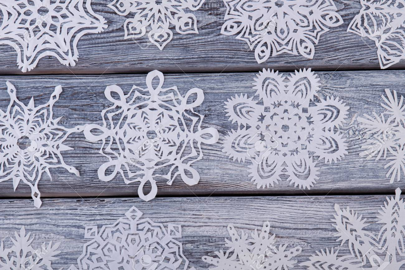 Diversity Of Paper Snowflakes On Wooden Background Set Of Homemade
