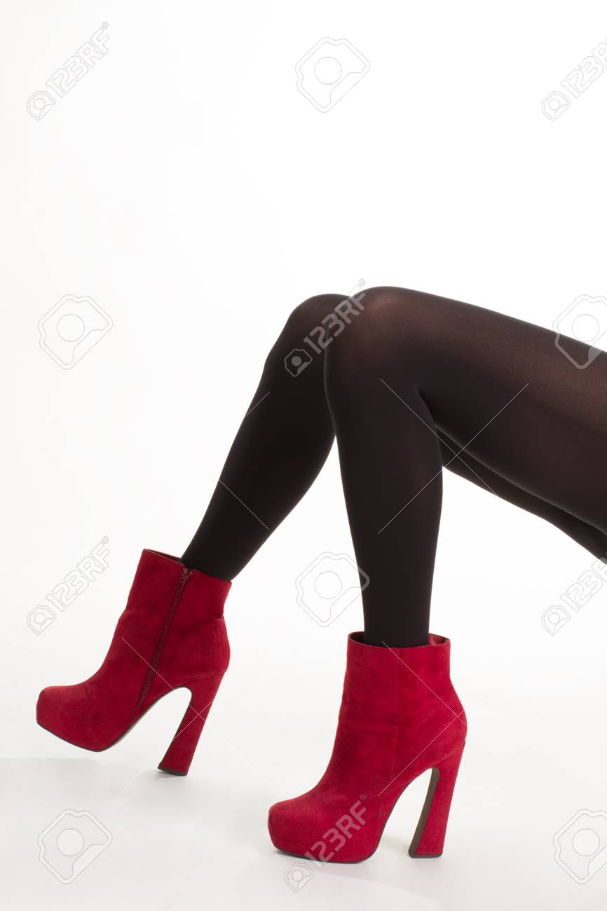 e6a27a489d2f Expensive suede ankle boots. Stylish designer footwear. Neat red shoes.  Young woman in