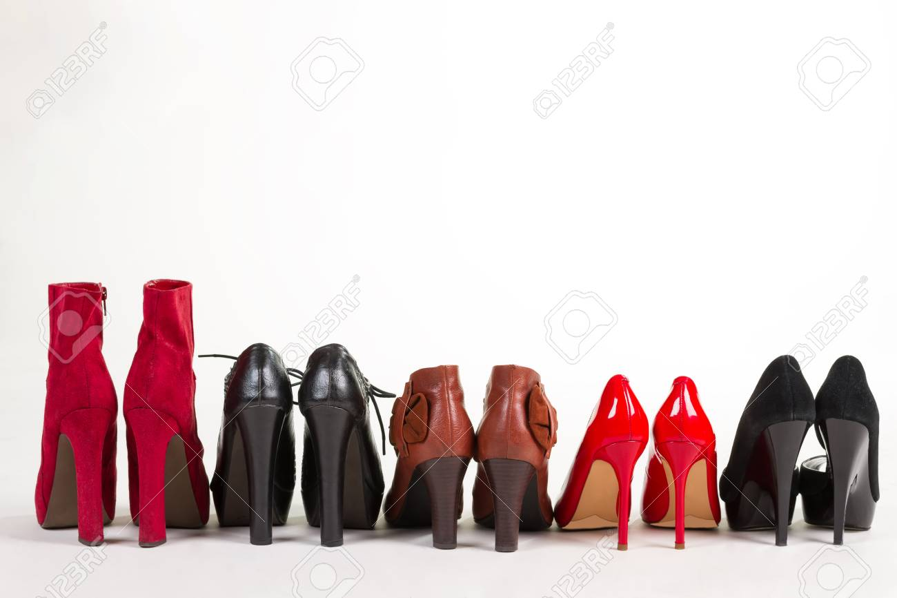 Beautiful new women\u0027s shoes lined up in a row. High,heeled shoes.