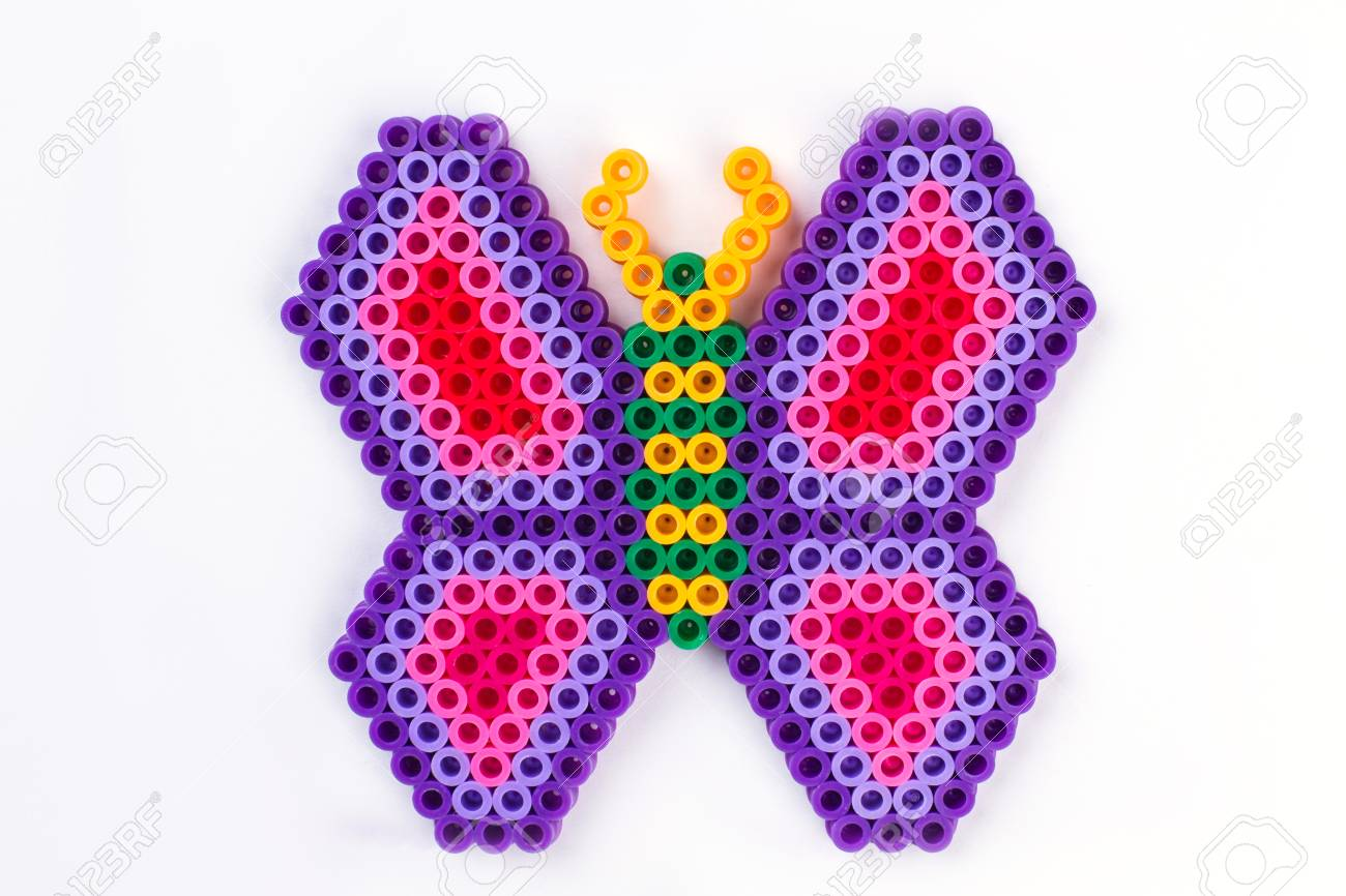 Perler bead butterfly  Close up  White isolated background