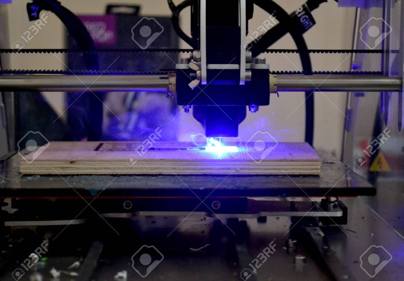 Laser engraving on wood macro  3D printer laser beam burns the
