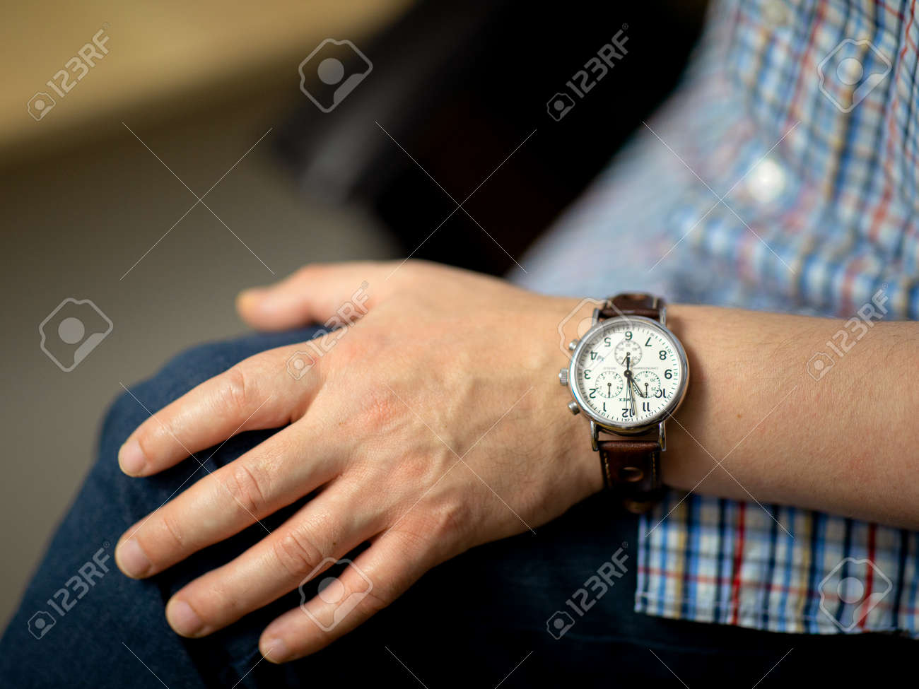 Classic men's timex watch with leather strap matched to the left hand with eleven o'clock - 161468082