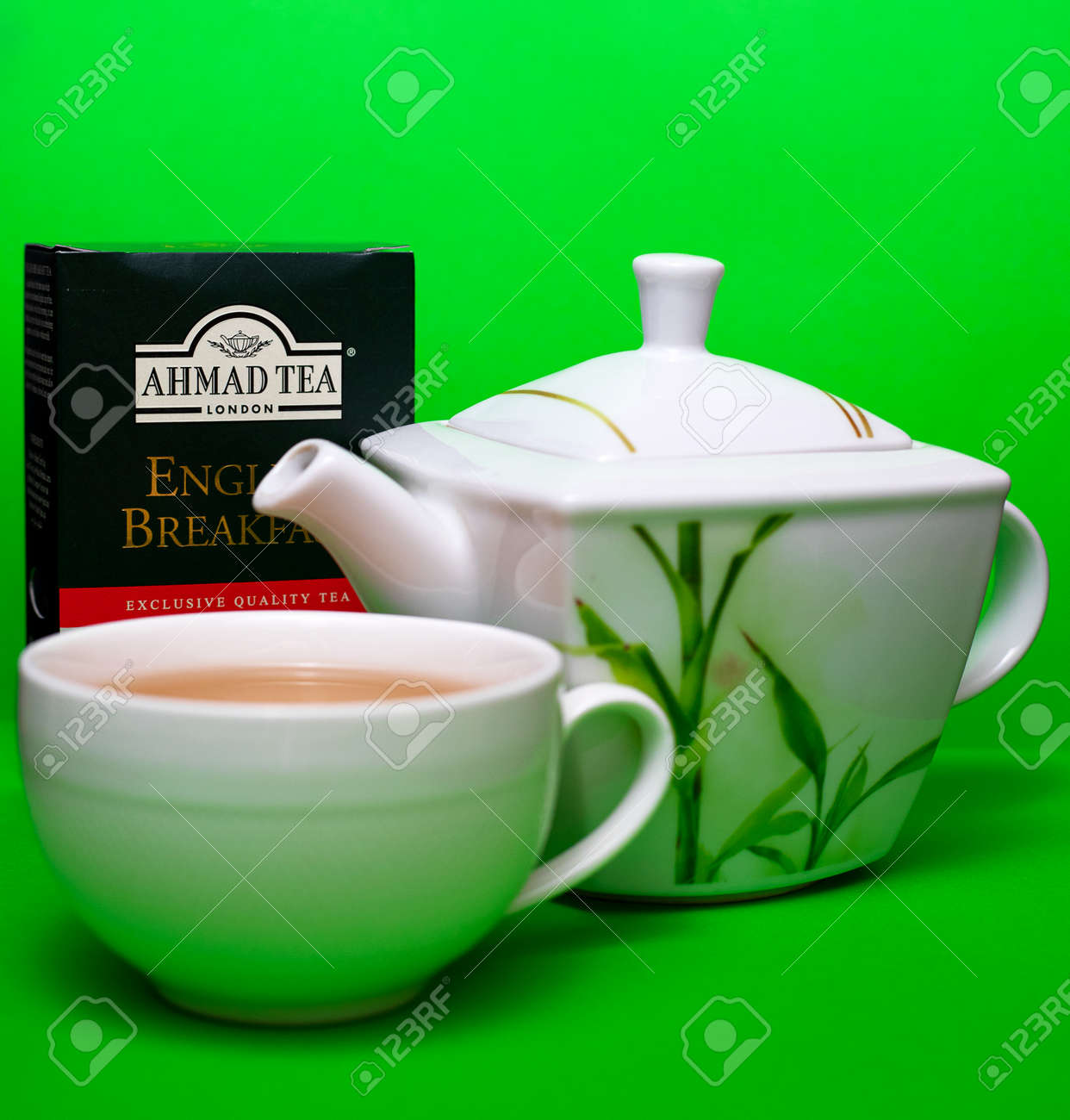 Teapot and cup of Ahmad black leaf tea on a green background. 01/06/2021. Warsaw, Poland - 162098057