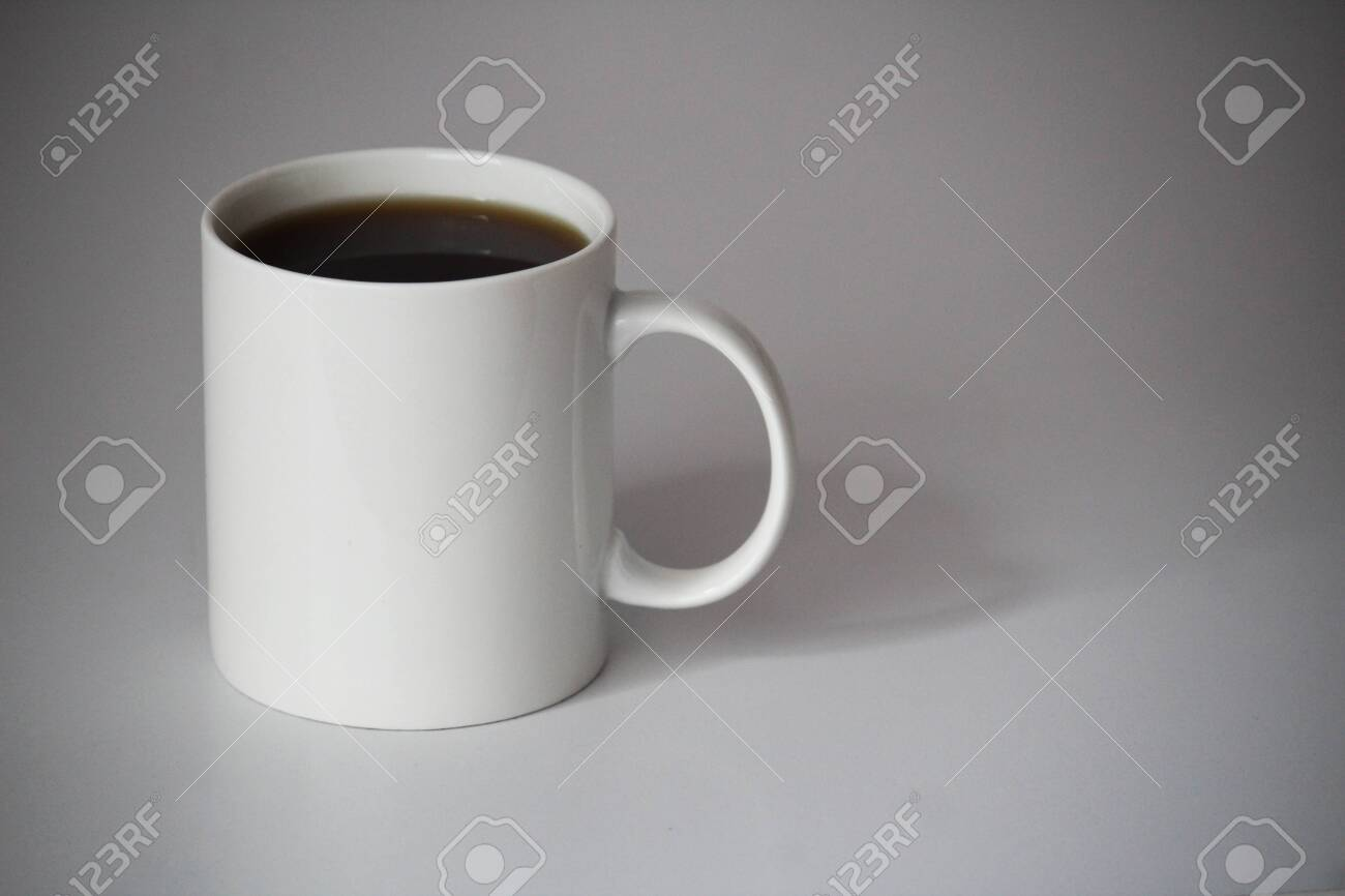 white cup of coffee for logo and design print on the office table background - 152846981