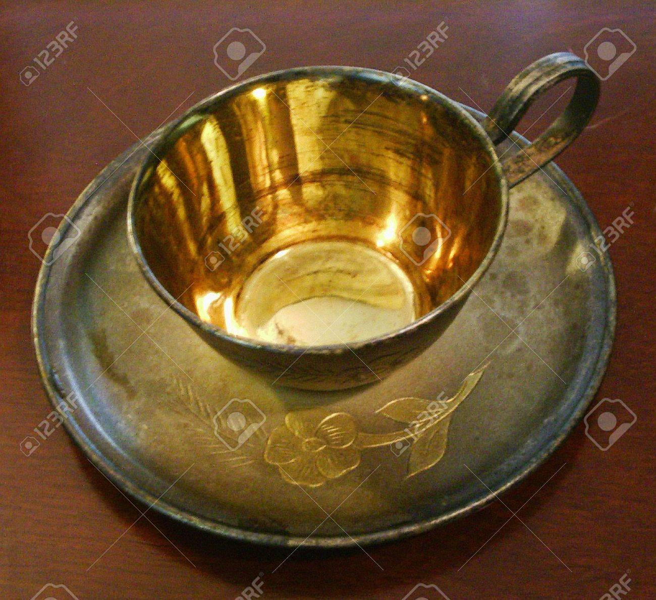 Silver gilded coffee cup and saucer Stock Photo - 1559232