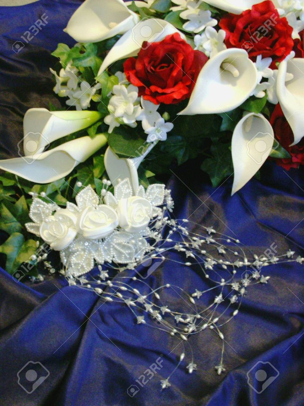 Bouquet and bridal headpiece on dark blue background Stock Photo - 1877853