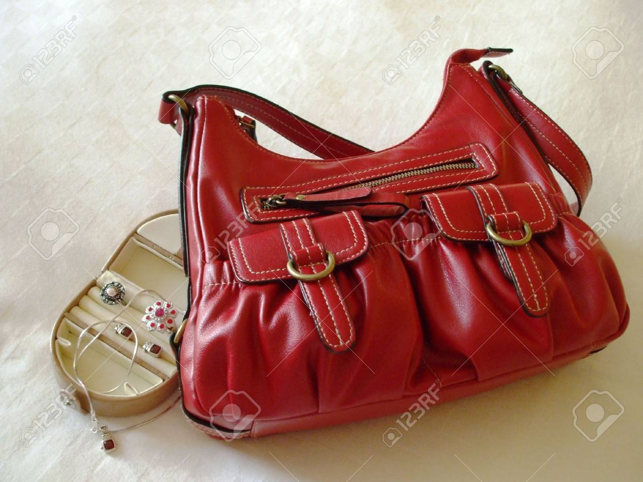 Small luggage - red handbag and a jewelry case Stock Photo - 3212642
