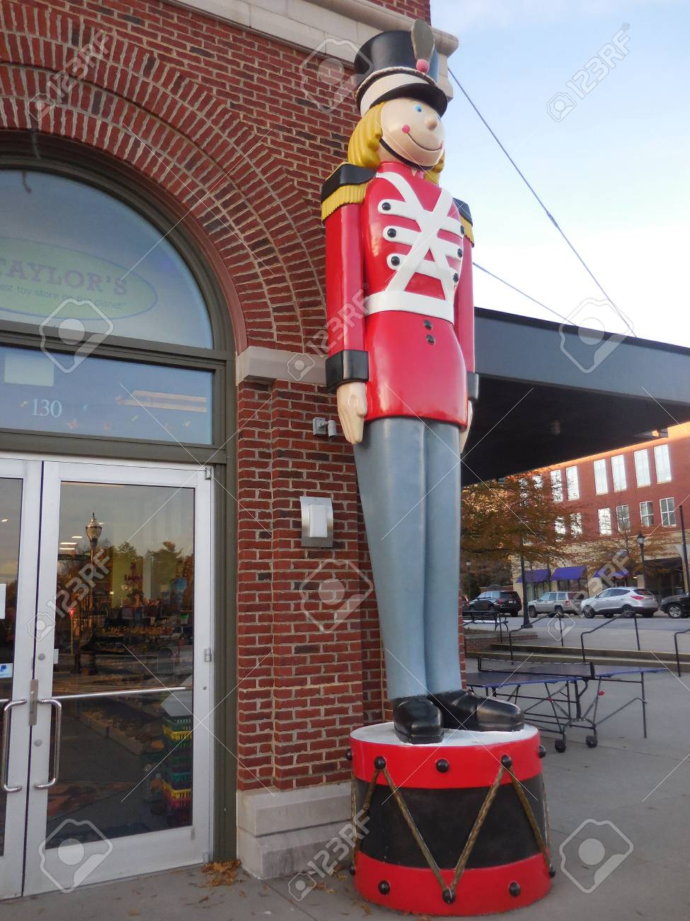 December 16, 2016 - Asheville, NC - Soldier at a toy store entrance Stock Photo - 78727534