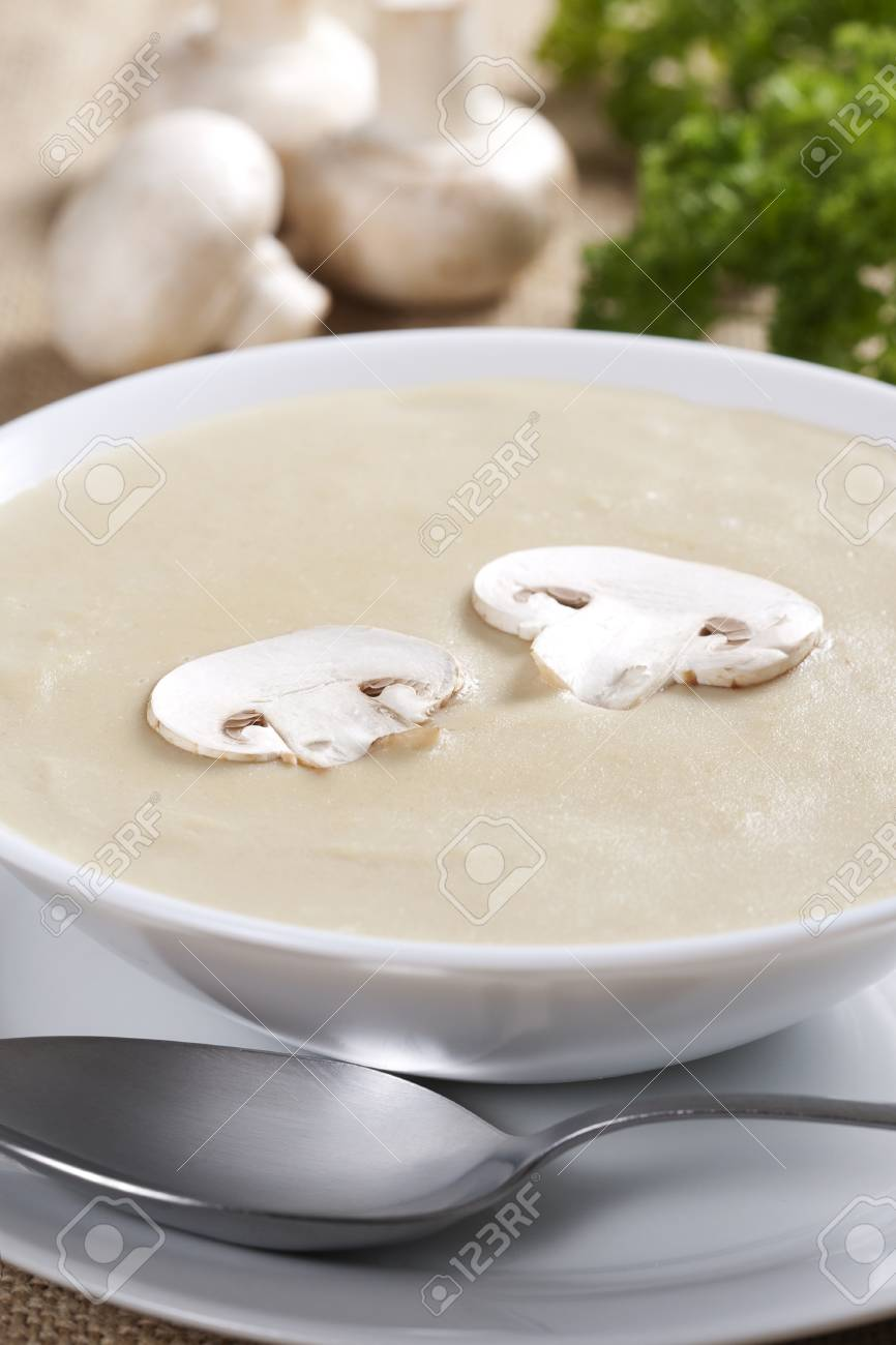 Bowl of mushroom soup with fresh mushrooms and parsley Stock Photo - 9255011