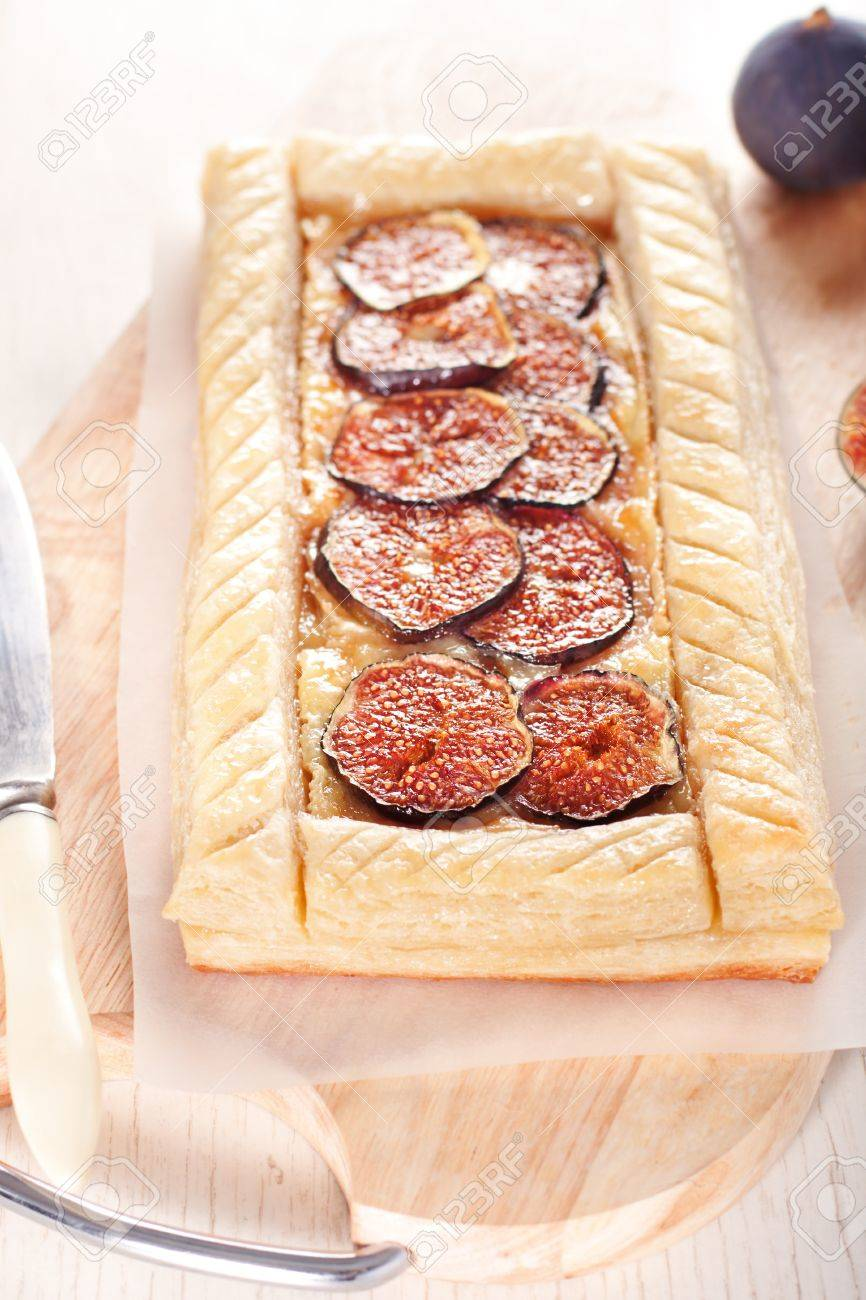 Gourmet puff pastry tart with figs, cheese and honey Stock Photo - 11207780
