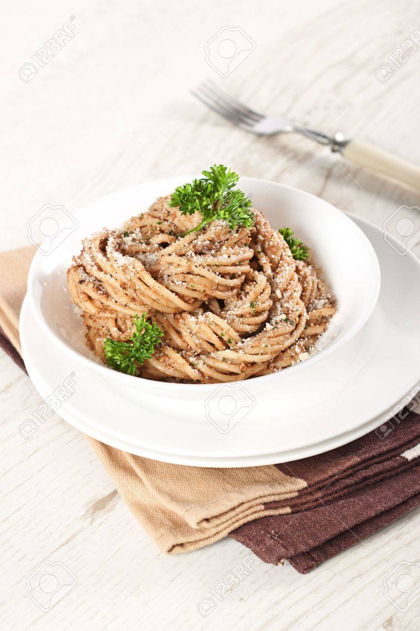 Tasty pasta with walnut cream sauce, cheese and parsley Stock Photo - 14842388