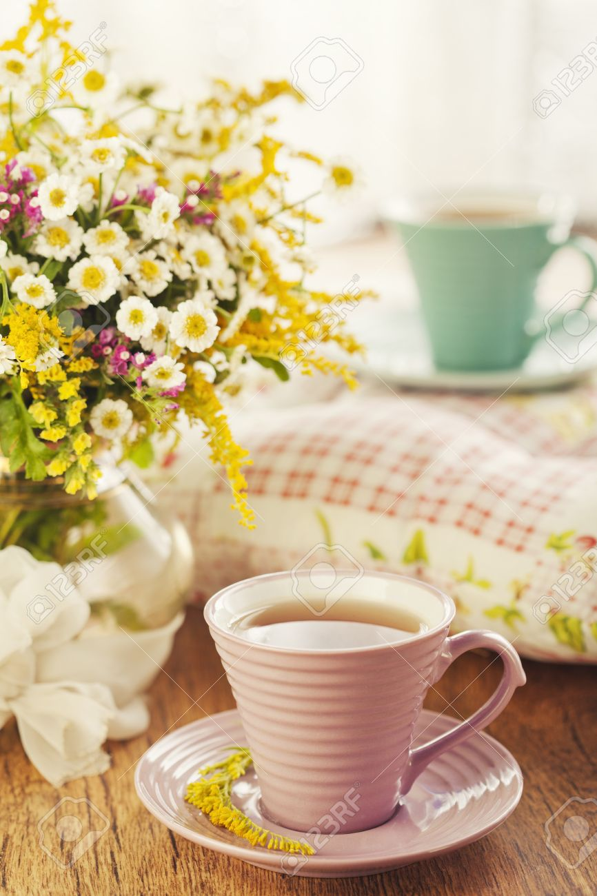 Two cups of tea and summer flowers Stock Photo - 14842401