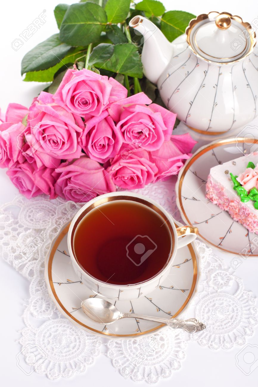Closeup of cup of tea with cake and roses Stock Photo - 14953892